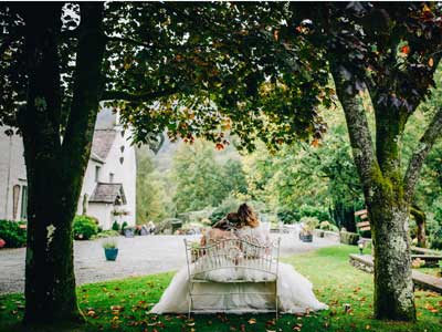 Two-brides-relaxing-in-the-gardens-at-Cote-How-by-Rachel-Joyce