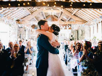 An indoor barn wedding cermeony by Rachel Joyce