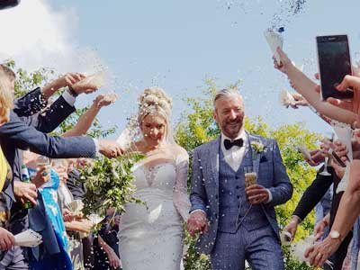 Confetti throwing symbolising Good Luck for the newly married couple
