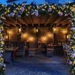 Gazebo - Lit with fairy lights, vintage festoon lights and peonies at dusk