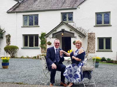 Older Couple have just eloped together to get married in the Lakes