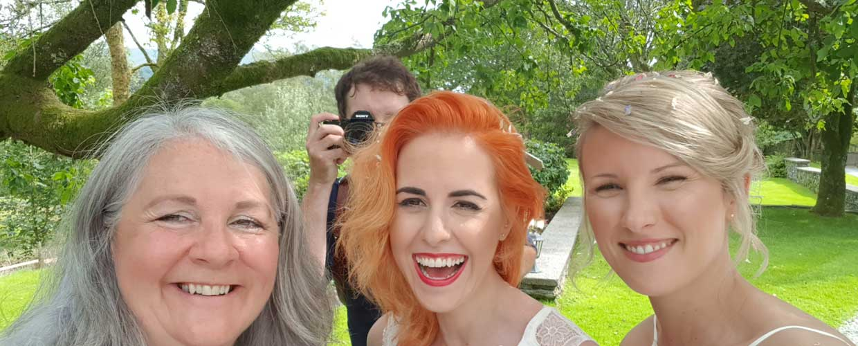 Wedding coordinator, Caroline with two beautiful brides and a great wedding photographer Tom McNally