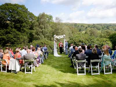 Humanist Wedding ceremony taking place outside on the lawn