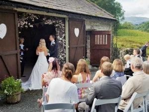 Small mid week wedding ceremony outside the rustic barn