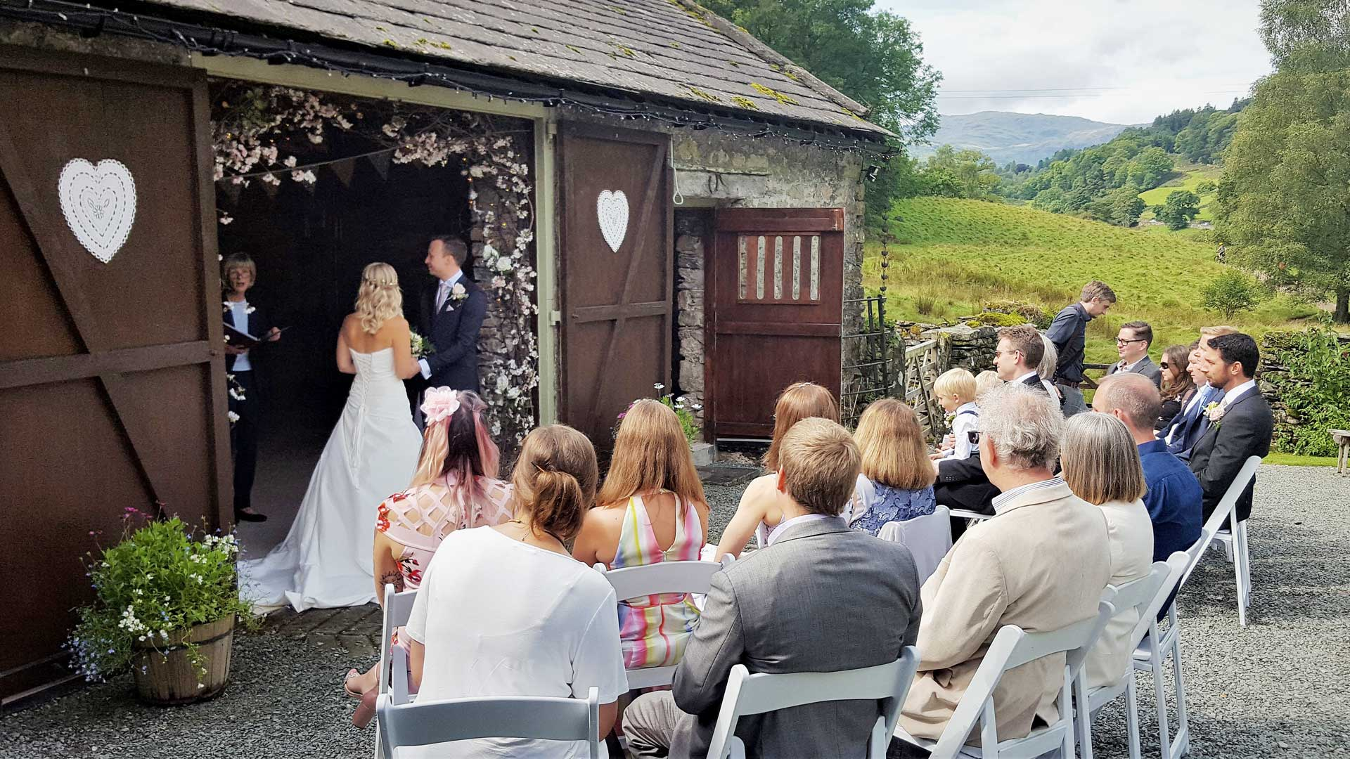 Small wedding ceremony outside the rustic barn