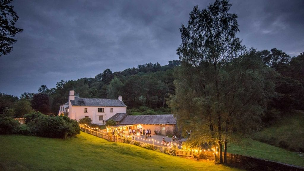 The Country House and Wedding Barn at Cote How illuminated at dusk twilight