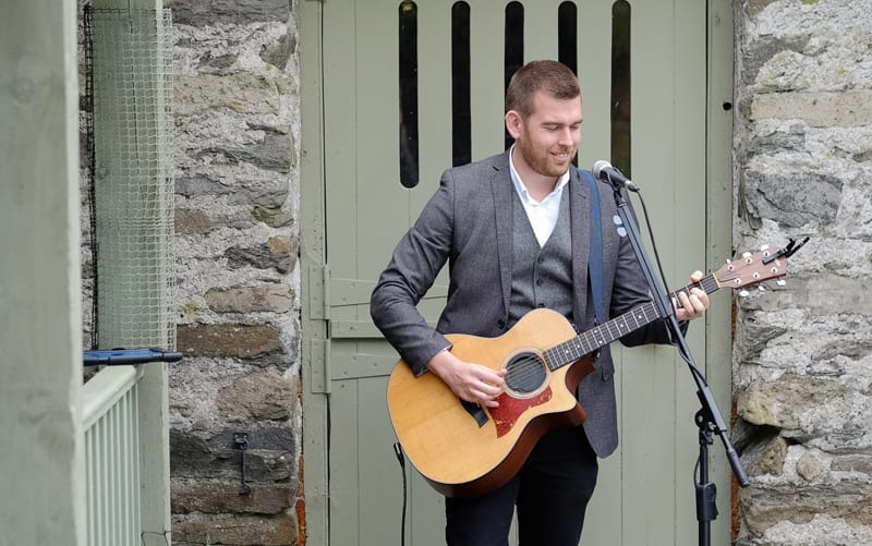 Alex Birtwell Wedding Entertainer singer outside the wedding barn