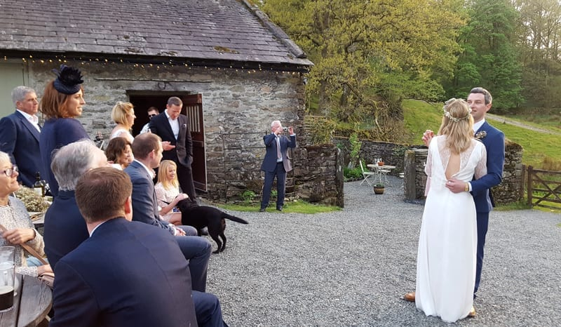 Alfresco-first-dance-as-thhe-sun-goes-down-over-Rydal