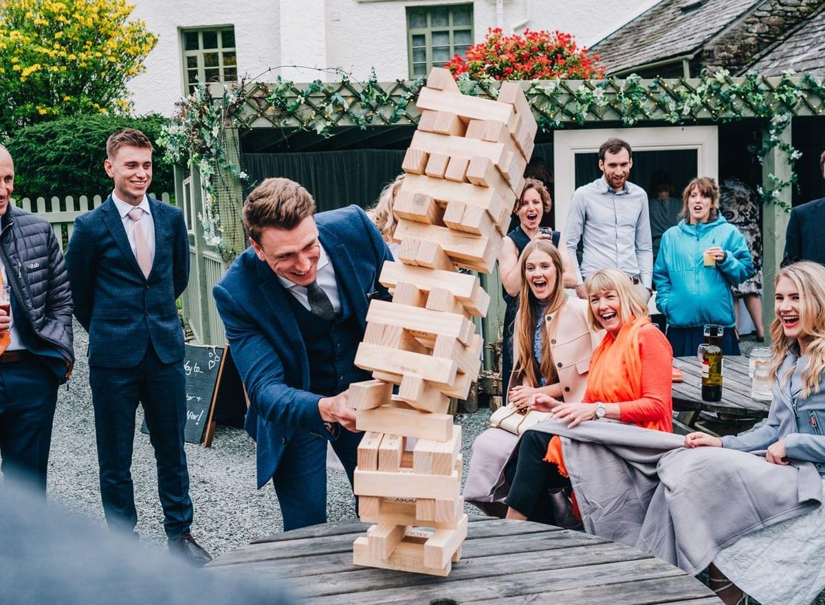 Family Fun Wedding playing Jenga outdoors