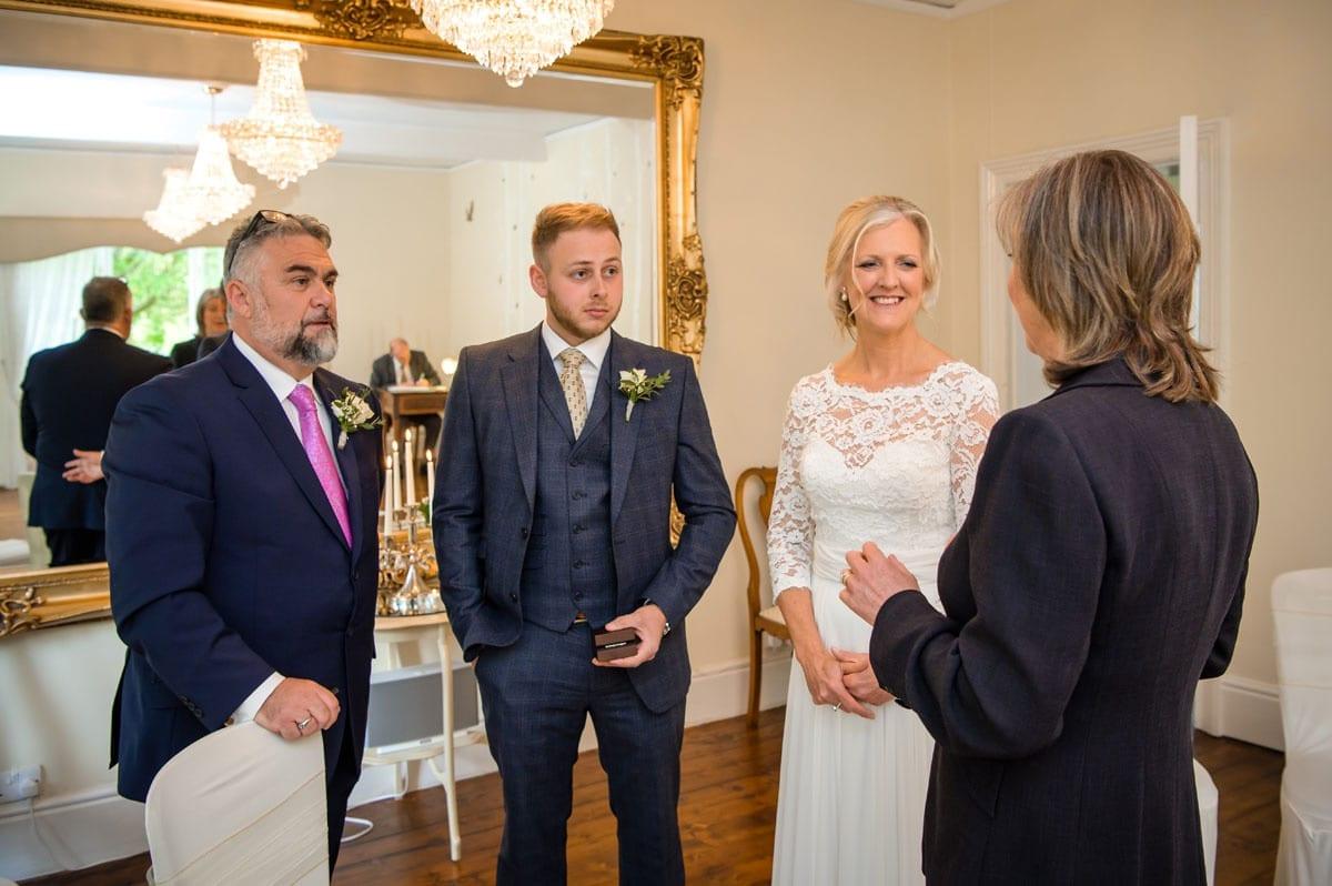 Getting-Married---Bride-nd-Groom-Chatting-to-the-Registrar-Pre-Wedding