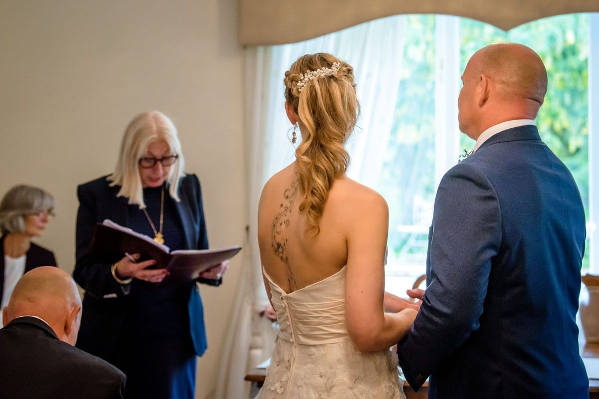 Getting-Married---Happy-Wedding-Couple-saying-their-marriage-vows