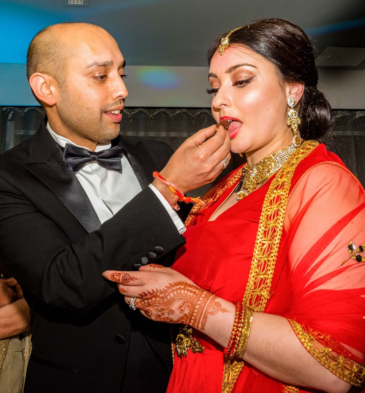 Asian Wedidng - Bride and Groom eating wedding cake