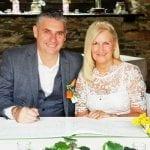 Mature Wedding Couple Signing Register Lakes Wedding