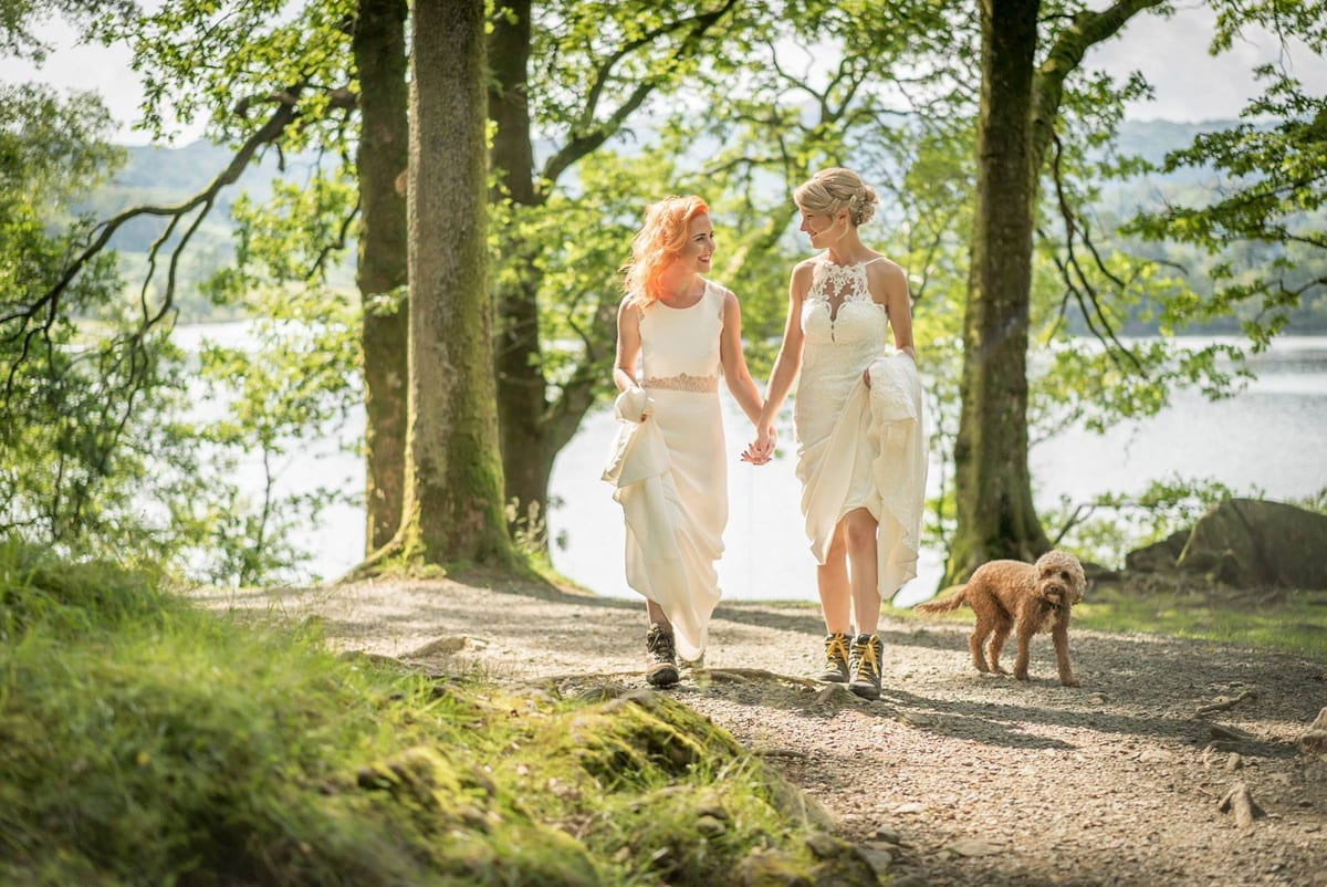 Two-Brides-strolling-through-Rydal-Woods-with-the-dog