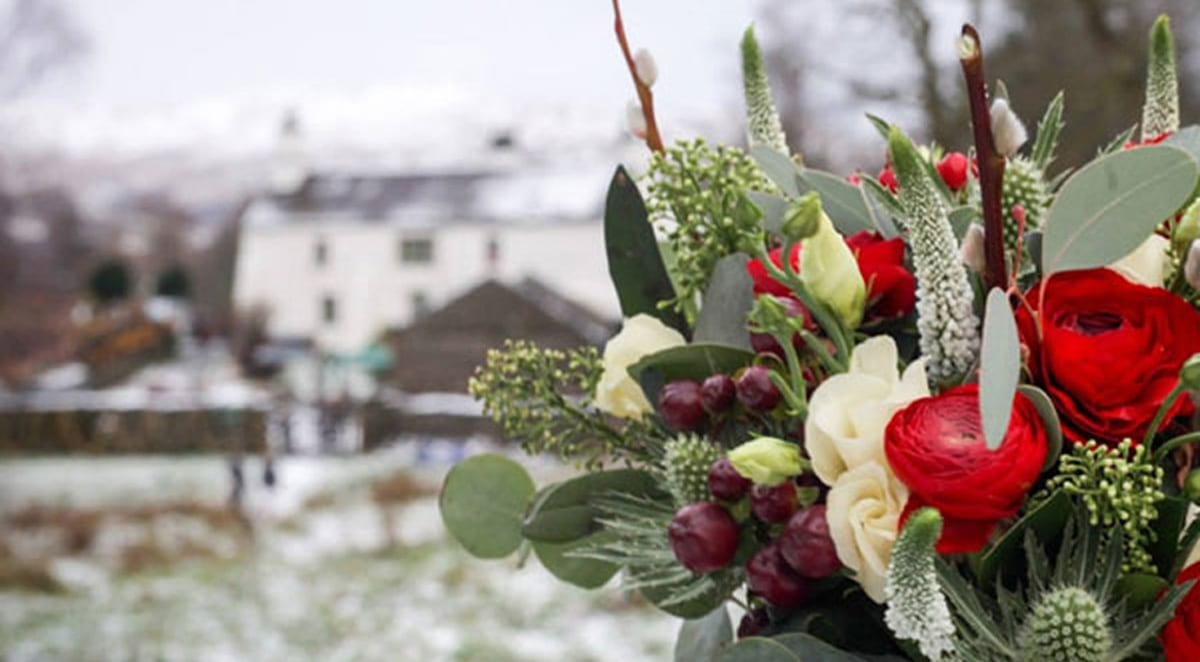 Stunning flower bouquet and small winter wedding venue