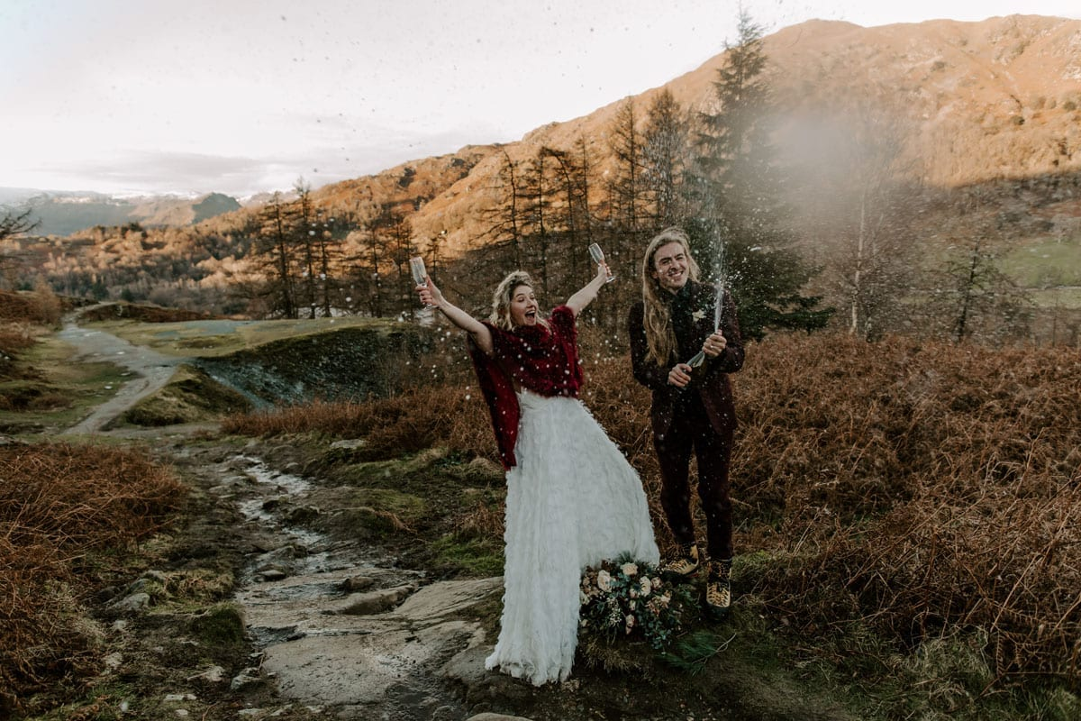 Cote-How-Elopement-Wedding-Couple-Popping-Prosecco-in-Celebration