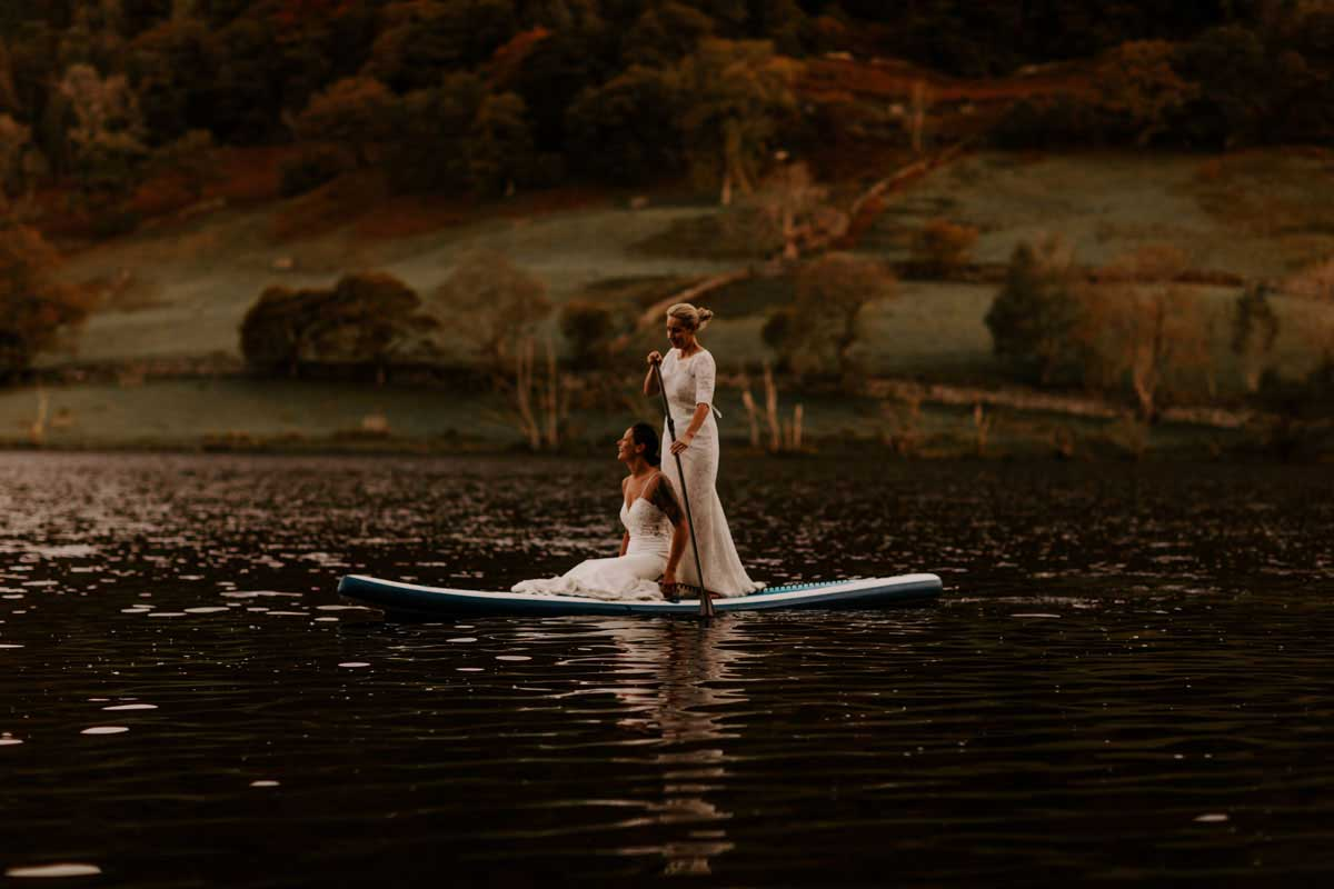 Two Brides on paddle board on rydal water