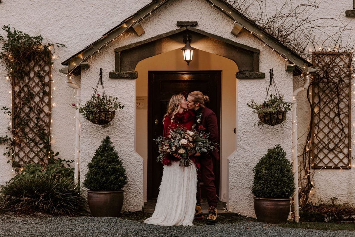 Couple in theTudor Porch at Wedding Venue