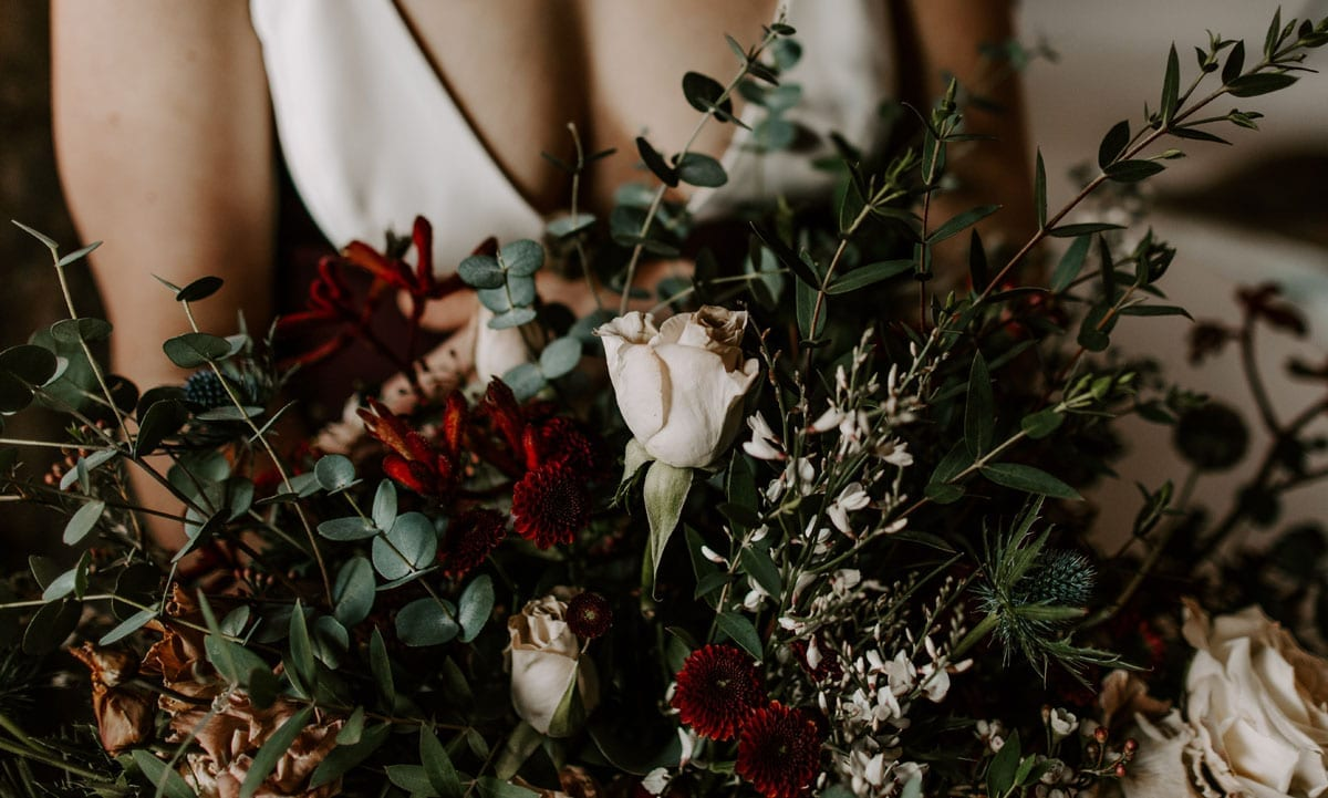 Winter Bridal Bouquet in Burgundy and Eucalyptus Green