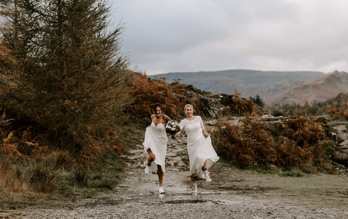 Two Brides Hiking in the mountains after their adventure wedding