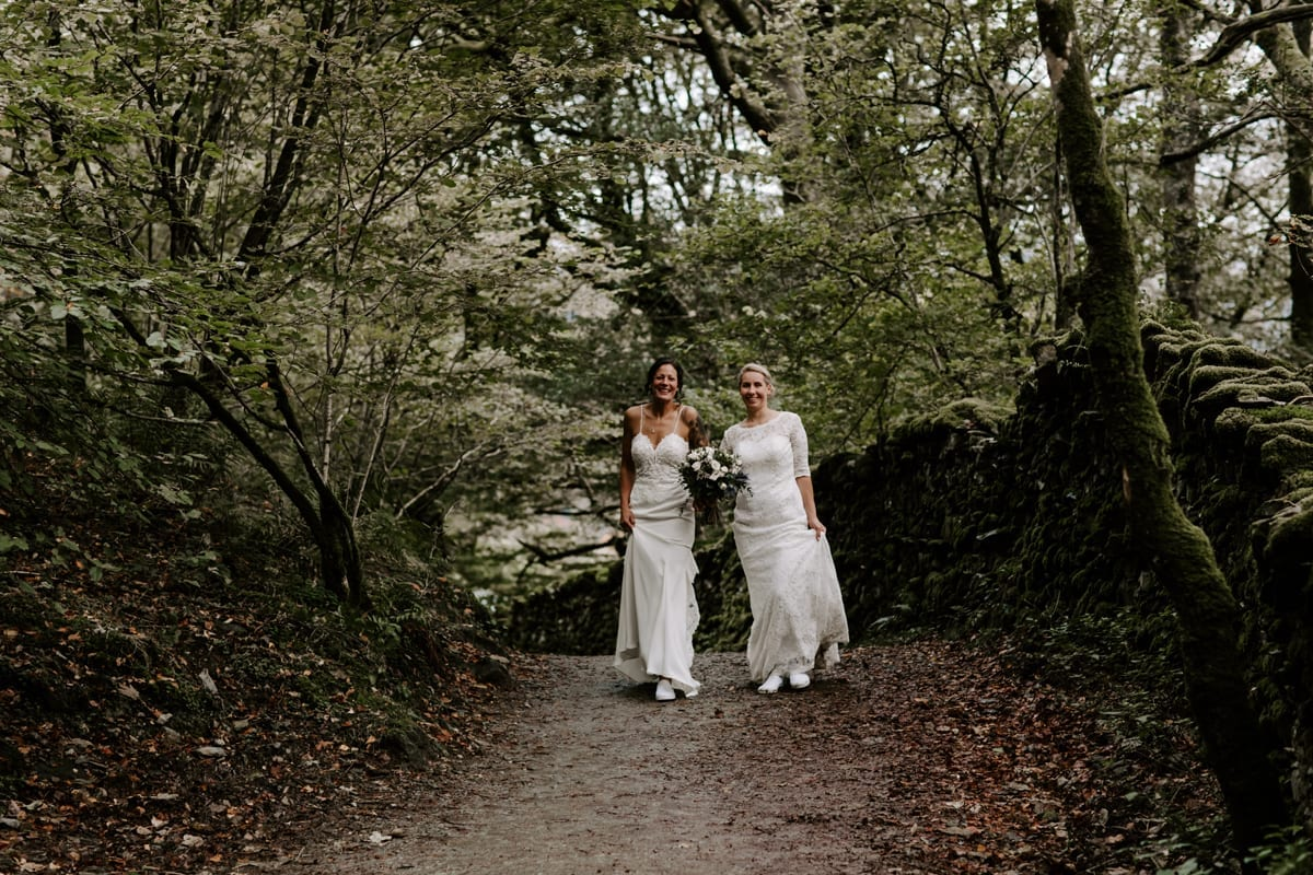 Brides hiking on their wedding day in the Lakes