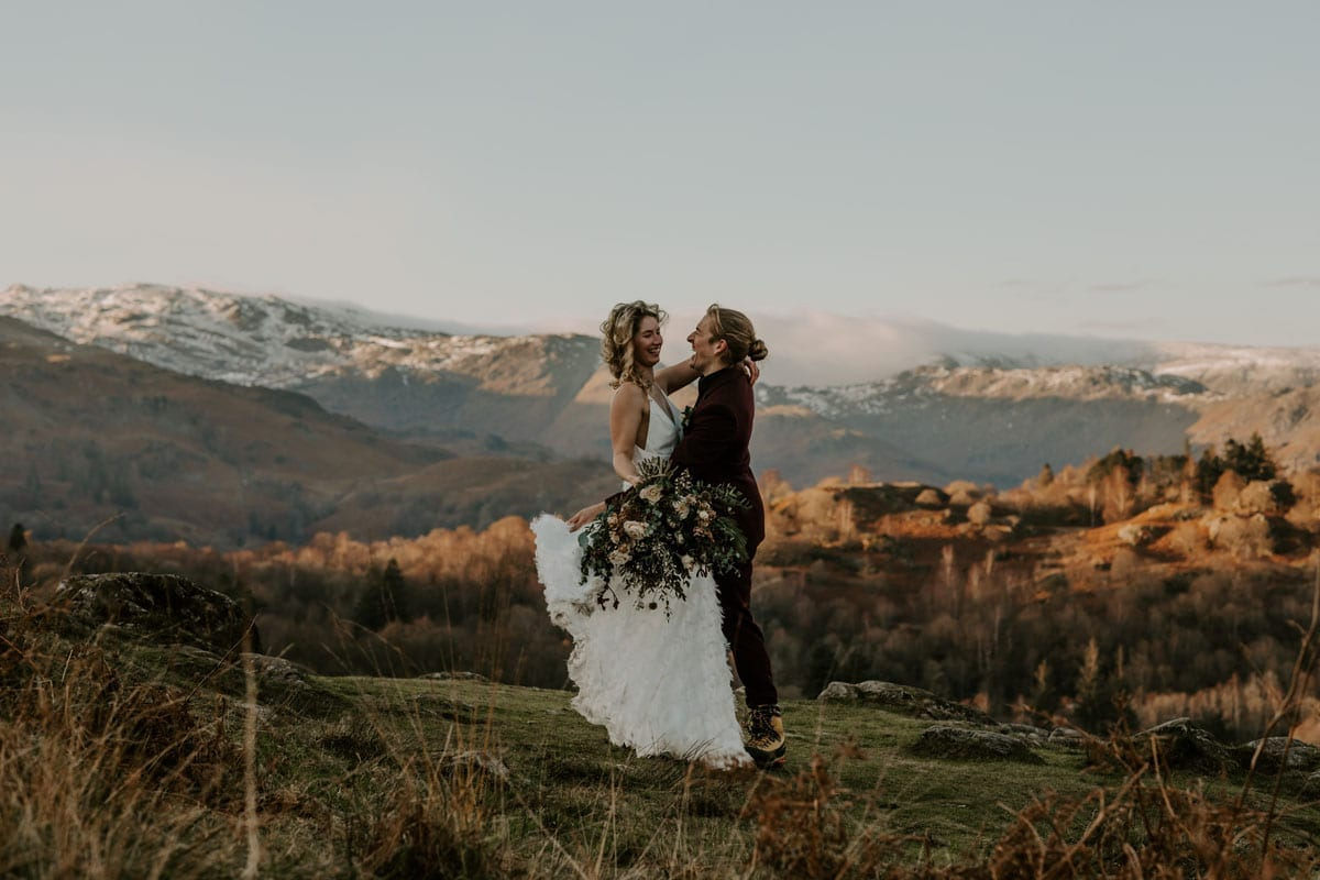 Wedding Couple celebrating their mountain wedding in the Lakes