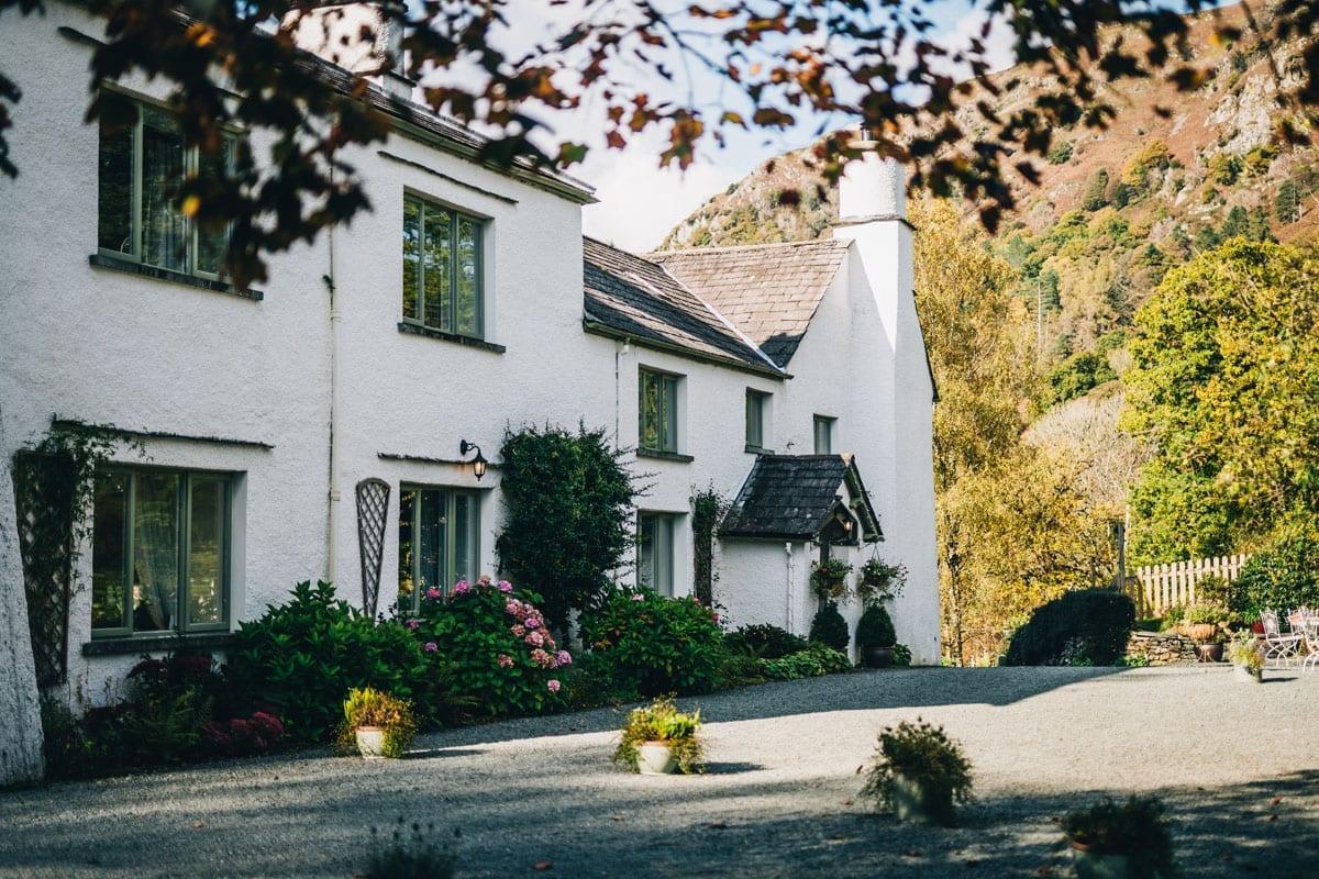 White Historic Farmhouse wedding Venue with Nab Scar mountain behind it