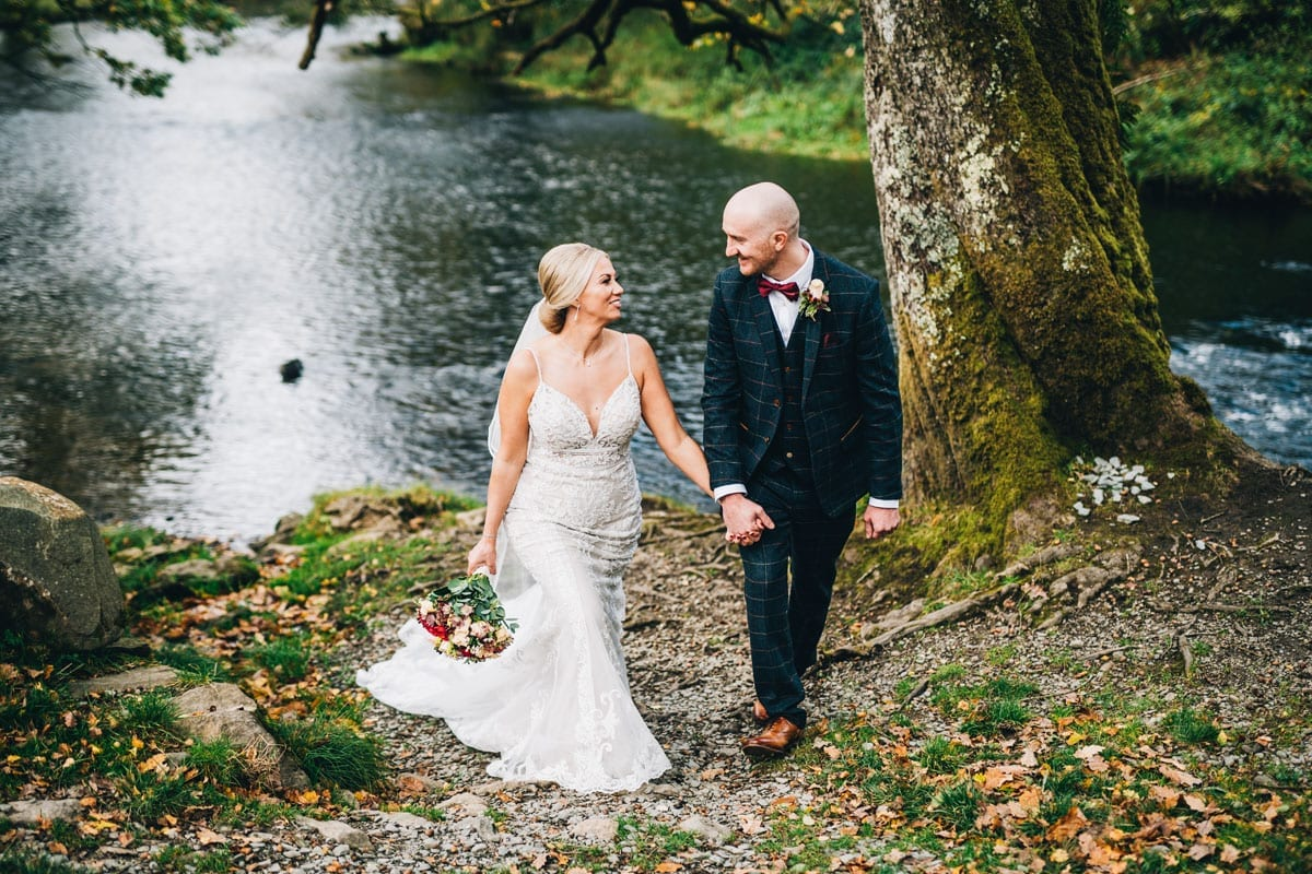 Bride and Groom by the River side of the Rothay River next to Cote How Lake District weddings