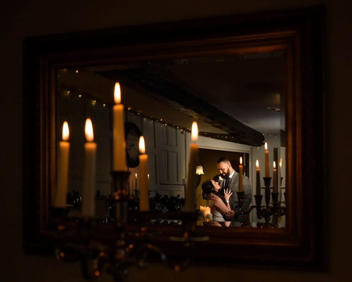 Candlelit-elopement-couple-in-mirror