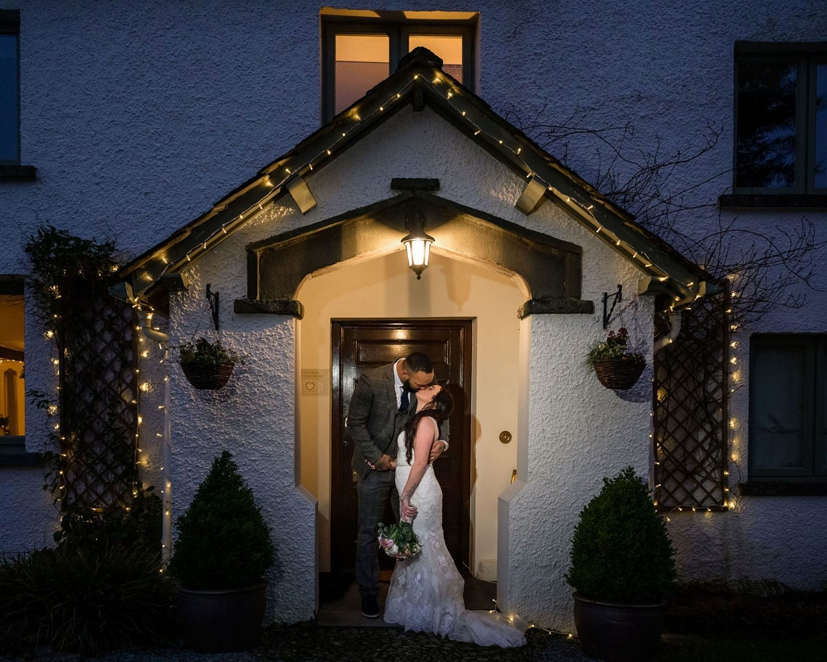 Elopement-couple-stood-in-Cote-How-porch