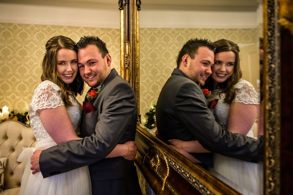 Wedding-couple-pictured-with-mirror-reflection