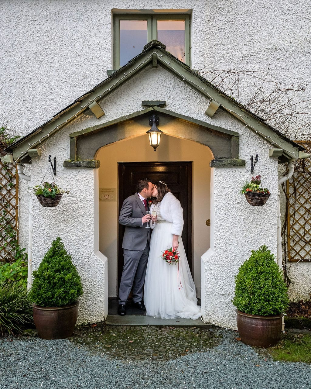 Wedding-couple-stood-in-Cote-How-porch