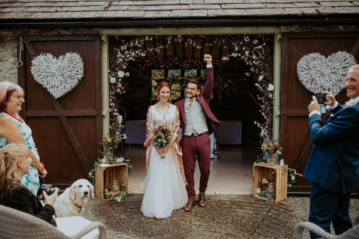 Bride and Groom in the arches of the barn for an al fresco wedding
