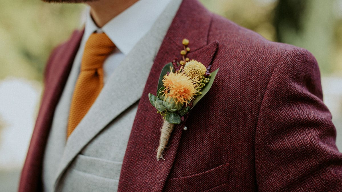 Grooms Burgundy suit and buttonhole