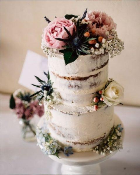 Semi-naked wedding sponge cake with fresh flower decoration